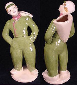 Pink clay pottery boy in green uniform by Hedi Schoop.