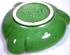 Green Camark ashtray with white unglazed foot, marked USA Camark 411