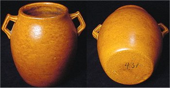 Orange Haeger 431 pot with crystalline glaze, which gives it a dark and light mottled pattern.