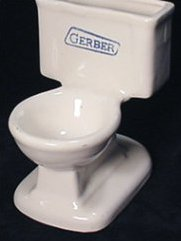 "Toilet figurine made from vitreous china, marked ""Gerber"""