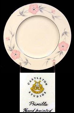 "Cream-colored porcelain plate with flowers. Display of mark from Castleton Studios, which reads ""Priscilla Hand painted"""