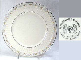 "Flintridge china porcelain plate with gold and grey leaf decorations on rim. Mark reads ""Flintridge China, Made in California, U.S.A.""."
