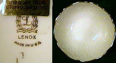 Cream colored pocelain bowl with leaves and 24 karat gold accents by Lenox.