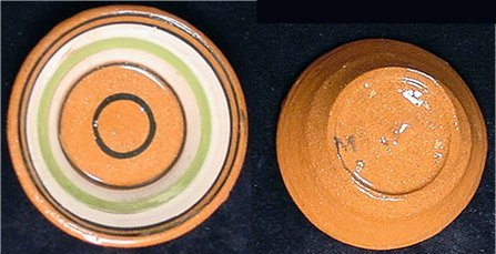 Red clay miniature bowl with white green and dark circles inside, handmade.