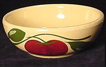 Yellow pottery bowl with a tomato vine and tomato decoration.