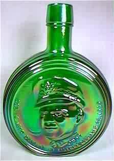 "Green glass bottle from Wheaton, New Jersey with Dwight ""Ike"" Eisenhower portrait on front. First Edition Commemorative."