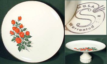 White cake plate with red roses off-center by Sabin Pottery.