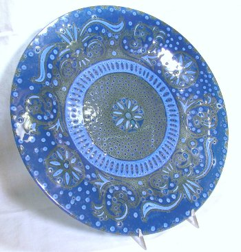 Blue fused art glass plate by Higgins with bubbles as part of the decoration.