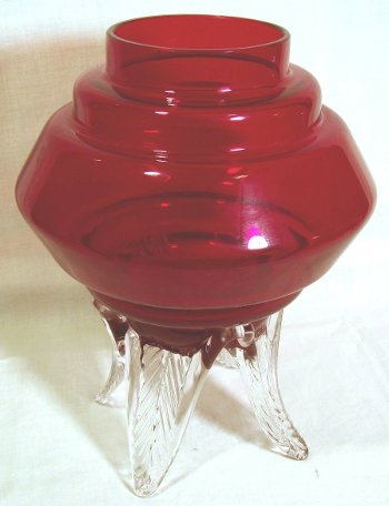 Lantern shaped red vase on three crystal legs by Morgantown Glass.