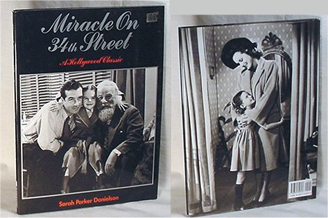 """Miracle on 34th Street: A Hollywood Classic"" by Sarah Parker Danielson: a book about the classic movie with stills and behind-the-scenes information. Edition is black with photo of three main characters posing on front."