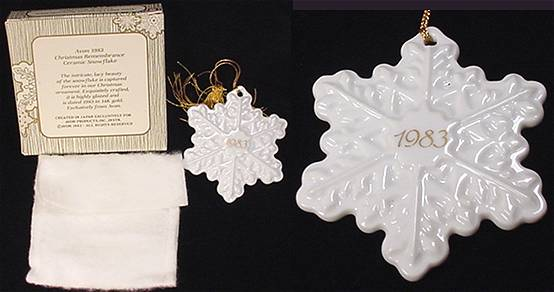 White ceramic snowflake with gold 1983 in center and tassel.