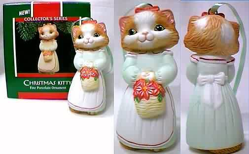"""Christmas Kitty"", orange and white, in white dress and apron with poinsettias, first in the series from Hallmark."