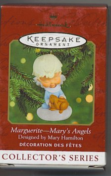 Angel in blue robe with a bunny, Marguerite from Mary's Angels by Hallmark.