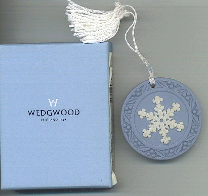 White snowflake on blue pendant with holly berries on edge. Jasperware by Wedgewood England.