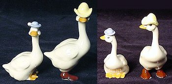 "Hagen Renaker geese, one in blue hat, one with yellow cowboy hat, called ""Mama and Papa Goose""."