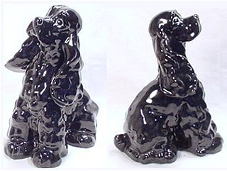 Black poodle dog figurine by Kay Finch posed looking up at presumed owner.