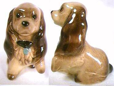 "'Lady' from ""Lady and the Tramp"" with a paw raised – Miniature by Hagen-Renaker."