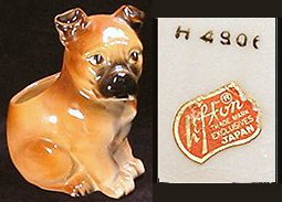 Brown boxer dog figurine from Lefton Japan, marked with sticker and number on bottom, with an open back.