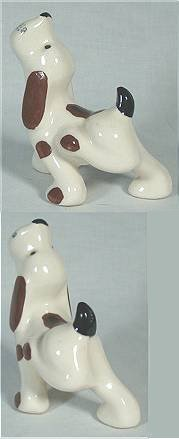 "White ""hillbilly"" beagle with brown spots and a black tail scratching while standing from Morton Pottery."