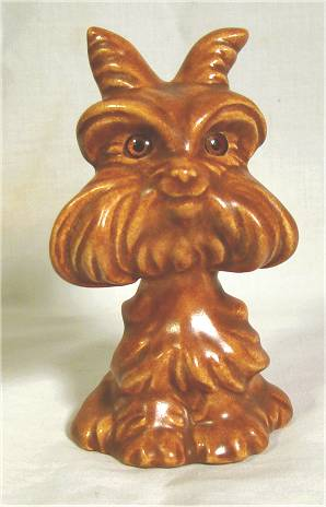 Stylized russet terrier figurine marked 'Roselane USA' by Roselane.