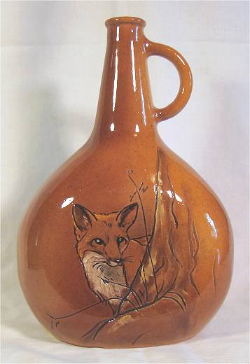 Brown vase with hand painted fox by Rick Wisecarver.