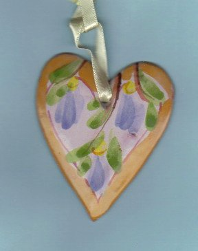 Pottery heart with leaves on tan ribbon by Ann Wheat Pace.