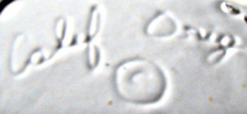 """Calif Orig"" in script mark with copyright circle used on California Originals pottery"