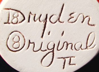 Incised Dryden Originals mark on light-colored clay with TL initials for Tony Lawson.