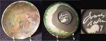 Evans Raku 77 mark on bowl with iridescent glaze.