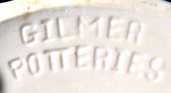 Gilmer Potteries in-mold mark in capital letters on white clay body.