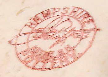 Red ink stamp on thin pottery shell dish from Hampshire Pottery J.S. Taft & Co in center script.