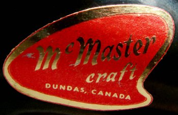 Red label for McMaster Pottery, Canada on drip glaze boot figurine.