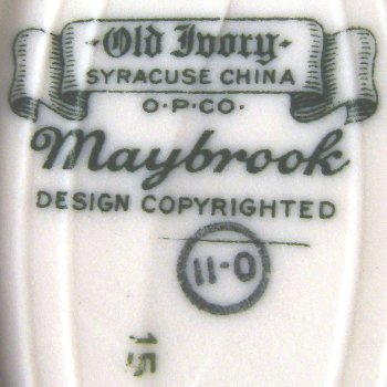 Old Ivory Syracuse China banner with O.P.Co mark on Maybrook soap dish.