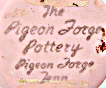 The Pigeon Forge Pottery black stamp mark on pink dogwood vase.