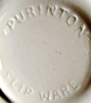 Purinton Pottery Slip Ware in-mold mark on large plaid decorated bowl.