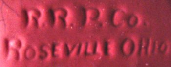R.R.P.Co. marked in mold on drip glaze bowl with fuchsia glaze.