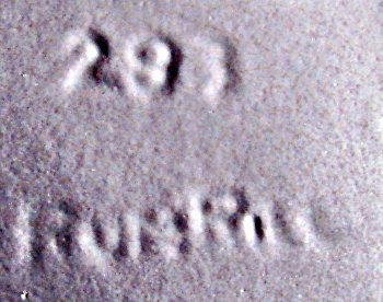 RumRill in-mold mark on green and lavender vase.