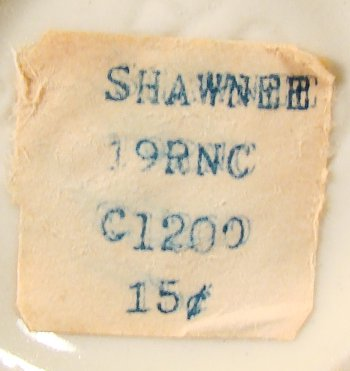 Shawnee Pottery paper tag on small vase with in-mold number visible.