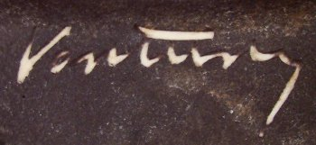 Vontury script signature on a dark colored background with beige clay .
