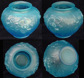 Sky blue satin glass poppy vase from Tiffin Glass.